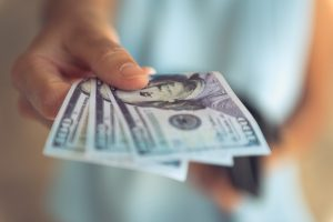 Female,Hands,Counting,Us,Dollar,Bills,Or,Paying,In,Cash